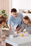 Serious loving parents helping their daughter with homework Royalty Free Stock Images