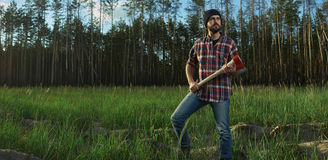 Serious Lumberjack with a big Ax in Hands Royalty Free Stock Image