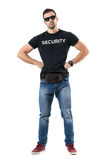 Serious macho bouncer or undercover officer with hands on hips looking at camera. Full body length portrait isolated on white studio background Royalty Free Stock Photo