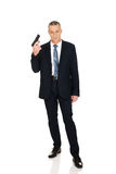 Serious mafia agent with handgun Stock Photo