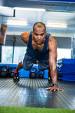 Serious male athlete doing push-ups Stock Image