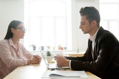Serious male boss reading resume considering applicant candidatu royalty free stock images
