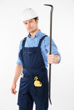 Serious male builder holding crowbar Stock Photo