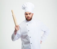 Serious male chef cook holding a rolling pin Royalty Free Stock Photography