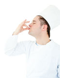 Serious male cook showing the sign for delicious Royalty Free Stock Photos