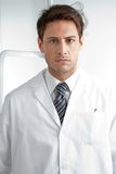 Serious Male Dentist In Clinic Stock Photography