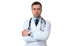 Serious male doctor crossed arms with stethoscope on white  Stock Images