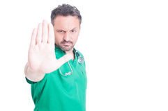 Serious male doctor doing stop gesture with hand Royalty Free Stock Images