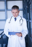 Serious male doctor using digital tablet Stock Images