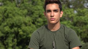 Serious Male Hispanic Teenage Soldier Recruit. A handsome hispanic male teen stock video