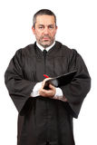 Serious male judge writing Royalty Free Stock Images