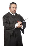 Serious male judge writing Royalty Free Stock Photo