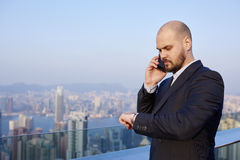 Serious male lawyer having mobile phone conversation during work break Stock Photo