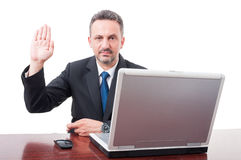 Serious male manager doing a false testimony Stock Image