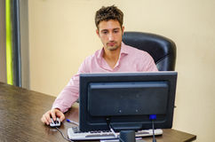 Serious male office worker at desk working Royalty Free Stock Photography