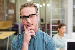 Serious male photo editor in office Royalty Free Stock Image