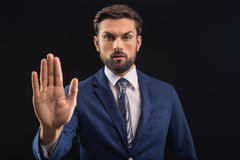 Serious male politician swearing in his innocence Stock Photos