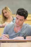 Serious male student during class. In the lecture hall Royalty Free Stock Photo