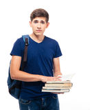 Serious male student holding books. Isolated on a white background. Looking at camera Stock Image