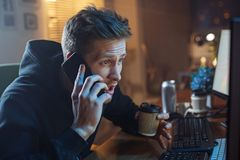 Serious male talking by phone stock images