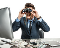 Serious male viewing through binoculars. Photos of modern businessman at the workplace royalty free stock photo