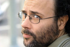 Serious Man. Portrait of a serious bearded man with glasses Stock Photos