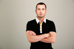 Serious man with arms folded Royalty Free Stock Photo