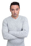 Serious man with arms folded Stock Photo