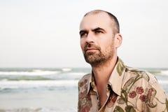 Serious man on the beachfront Stock Photos