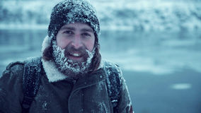 Serious man with beard in snow Stock Photo