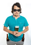 Serious man with beer glass Royalty Free Stock Photos