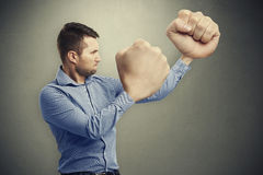 Serious man with big fists Royalty Free Stock Image