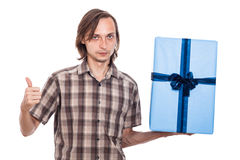 Serious man with big present Royalty Free Stock Photography