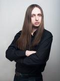 Serious man in black shirt. Studio portrait Stock Image