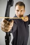 Serious man with bow Stock Photo