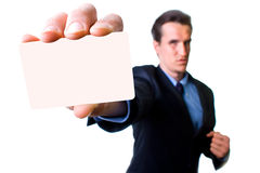 Serious man with business card stock photography
