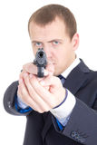 Serious man in business suit aiming gun at camera isolated on wh Stock Photo