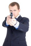 Serious man in business suit aiming gun isolated on white Stock Images