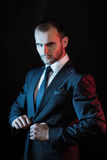 Serious man in a business suit, dark background Royalty Free Stock Photos