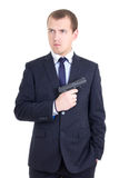 Serious man in business suit with gun isolated on white Royalty Free Stock Photos