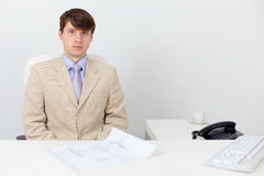 Serious man in a business suit at work in office Royalty Free Stock Photo