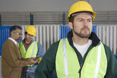 Serious Man With Colleagues In Factory  Stock Photos