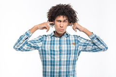 Serious man covering his ears Royalty Free Stock Photography
