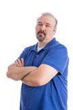 Serious Man Crossing his Arms in Aggressive Look. Portrait of a Serious Bearded Man in Blue Polo Shirt, Crossing his Arms and Looking at the Camera in an Royalty Free Stock Images