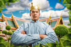 Serious man with crown Stock Photography