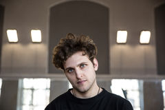Serious man with curly hair Royalty Free Stock Image
