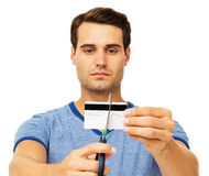 Serious Man Cutting Credit Card Stock Photo