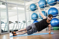 Serious man doing exercise on the mat Royalty Free Stock Photo