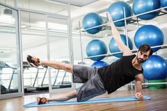 Serious man doing exercise on the mat Royalty Free Stock Images