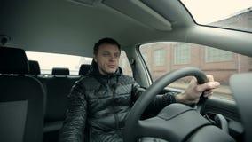 Serious man driving a car stock footage